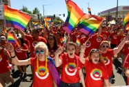 Melany Austad, middle, Macey Moyer, left, and Kaylee Flaherty, right, all of whom work for Target, wave rainbow flags as they take part in the 42nd annual PrideFest Parade on June 18, 2017 in Denver, Colorado. Denver PrideFest is ColoradoÕs largest regional celebration of LGBT Pride. The parade started in Cheesman Park headed west on Colfax Ave and ended at Civic Center. The festival included live entertainment on three stages, as well as more than 200 vendors, food and drink. Denver PrideFest is the largest annual fundraiser for the GLBT Community Center of Colorado, a non-profit organization that serves more than 47,000 people annually with programs for LGBT youth, seniors, ColoradoÕs transgender community, and training and legal programs. Over 180 different organizations participated in this year's parade. (Photo by Helen H. Richardson/The Denver Post)