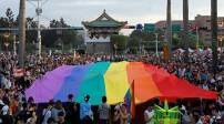 Participants hold a giant rainbow flag as they take part in a lesbian, gay, bisexual and transgender (LGBT) pride parade in Taipei, Taiwan, October 28, 2017. REUTERS/Tyrone Siu