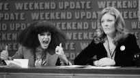"SATURDAY NIGHT LIVE -- Episode 17 -- Pictured: (l-r) Gilda Radner as Roseanne Roseannadanna, Jane Curtin during ""Weekend Update"" -- Photo by: NBC/NBCU Photo Bank RESTRICTED"